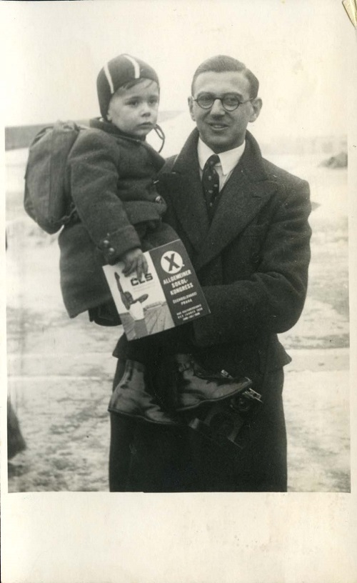 Nicholas Winton holds a boy who was being flown from Prague to London in January 1939.