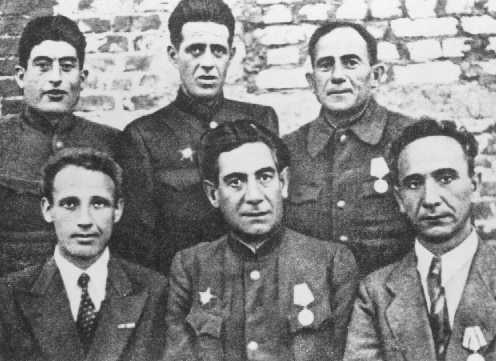 Jewish partisan leaders from Minsk soon after liberation. From left to right: (first row) B. Chaimowicz, S. Zorin, H. Smoliar; (second row), C. Feigelman, Y. Kraczynsky, and N. Feldman. 1944