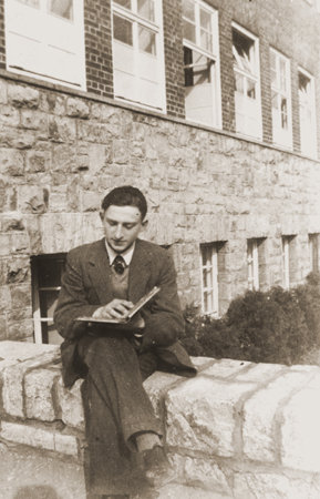 Gerd Zwienicki studies outside the Wuerzburg Jewish teachers seminary shortly before it was closed down on Kristallnacht. Wuerzburg, Germany, 1938.