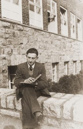Gerd Zwienicki studies outside the Wuerzburg Jewish teachers seminary shortly before it was closed down on Kristallnacht. Wuerzburg, Germany, 1938.
