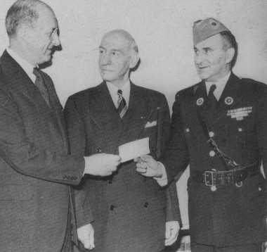 Secretary of the Treasury Henry Morgenthau, Jr., accepts a donation of $30,000 (for war planes) from the Jewish War Veterans organization. Washington, DC, United States, 1942.