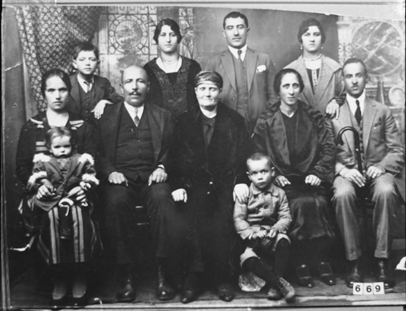 Portrait of an unidentified family, eight adults and three children, in Bitola.