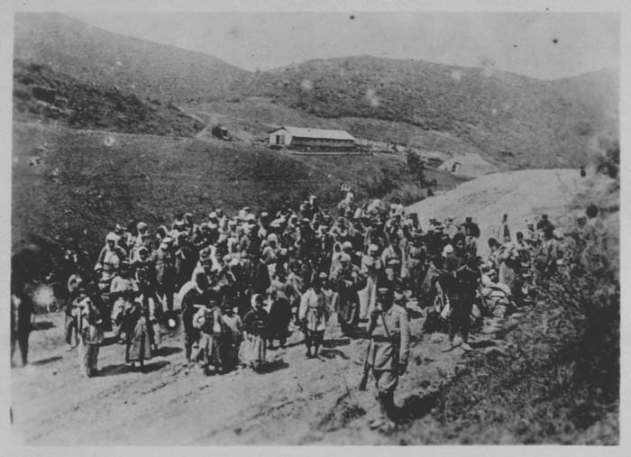 Ottoman troops guard Armenians being deported. Ottoman Empire, 1915-16.