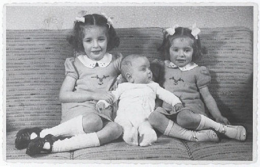 Eva, Alfred, and Leane Munzer. Infant Alfred survived in hiding; his sisters were discovered and killed in Auschwitz.