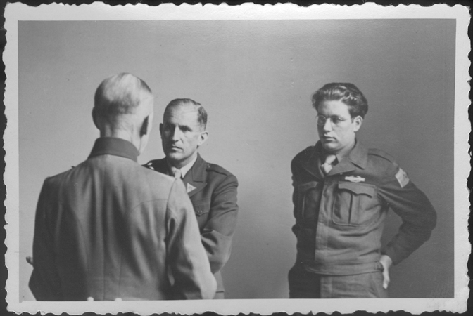 German Field Marshal Gerd von Rundstedt (with his back to the camera) speaks to American prosecutor Robert Kempner (left) and interpreter Gerald Schwab during a pause at the IMT Nuremberg commission hearings investigating the Supreme Command of the German Armed Forces. June 19, 1946.