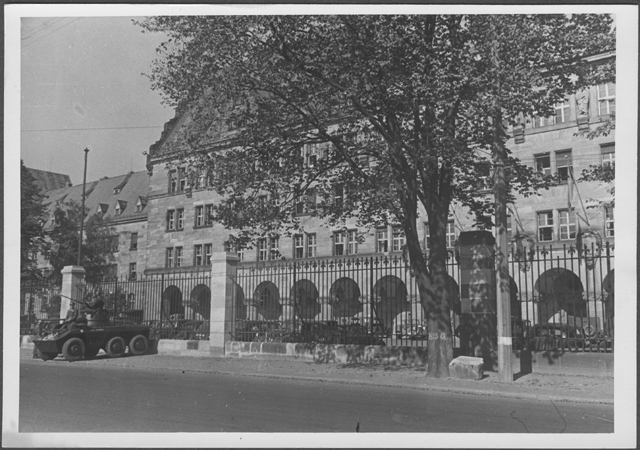 An armored car parked outside the gate of the Palace of Justice in Nuremberg on the day the judgement of the International Military Tribunal was handed down. Nuremberg, Germany, October 1, 1946.