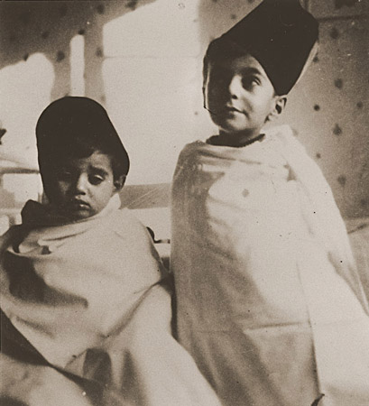Tom (left) and Wolf Stein (right), dressed in Turkish-style costumes, attend a party celebrating the Jewish holiday of Purim. Hamburg, Germany, 1936.