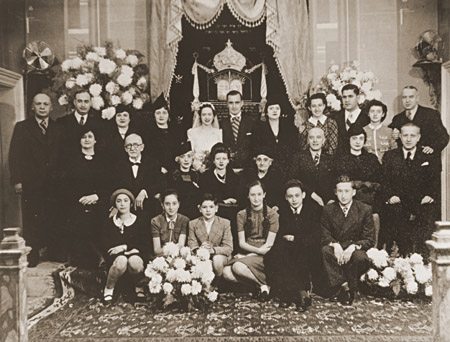 Bride and groom Laura Uziel and Saul Amarillo (center) pose with their extended families during their wedding. Salonika, Greece, 1938.