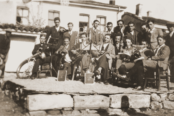 A group of Macedonian Jewish youth, members of a band, pose with their instruments on a makeshift stage in Bitola. September 18, 1930.