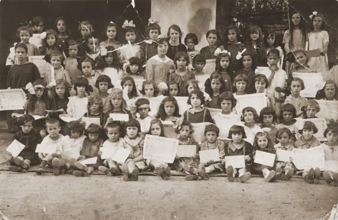 Group portrait of children holding their diplomas at a school in Bitola. Between 1925 and 1938.