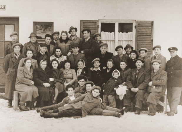 Group portrait of former Bielski partisans from Nowogrodek taken in the Foehrenwald displaced persons camp. Germany, April 3, 1948.