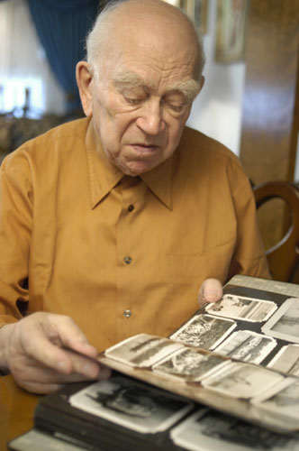 Norman Salsitz looks through his prewar family photographs. 2004.