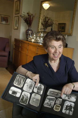 Regina Gelb shows her prewar family photographs. 2004.