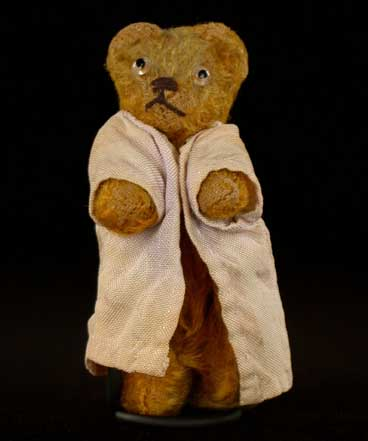 """At some point after the war, Sophie received this small stuffed bear (about three inches high) as a present from her mother. She named it """"Refugee,"""" just like she and her mother were refugees of the war."""