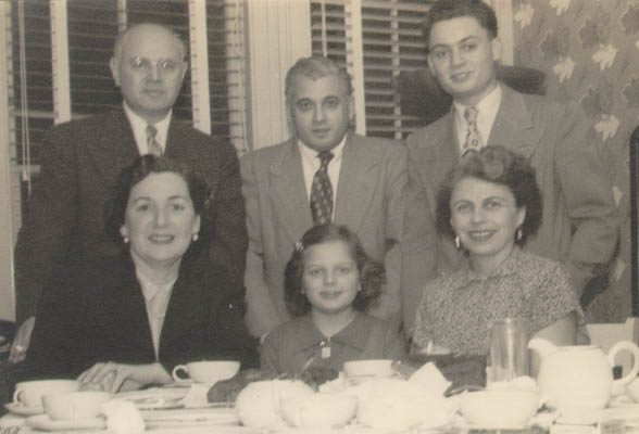 "Thomas (standing, right), then known as ""Tommy,"" with relatives shortly after arriving in the United States. New Jersey, ca. 1952."