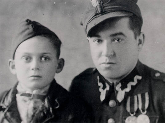 Thomas (left), 6 months after liberation, with a soldier who realized that Thomas was Jewish and took him to an orphanage, ca. 1945. Thomas was eventually reunited with his mother.