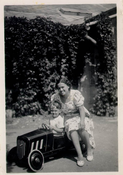 Thomas in his toy car, 1936.