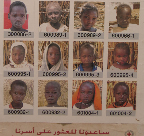 "International Red Cross Poster showing photographs of children in refugee camp in Chad. Titled ""Help us find our family."" Chad, 2005."