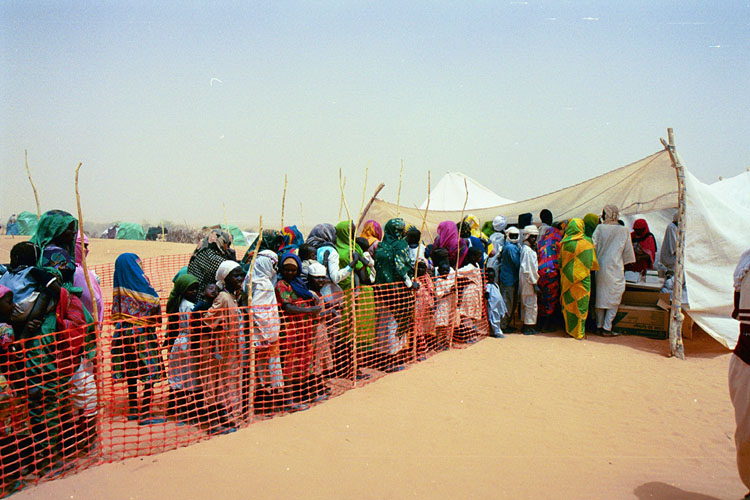 Refugees line up in a camp in eastern Chad for refugees from the Darfur region of neighboring Sudan. Jerry Fowler, Staff Director of the Museum's Committee on Conscience, visited in May 2004 to hear firsthand the refugees' accounts of the genocidal violence they faced and of being driven into the desert.