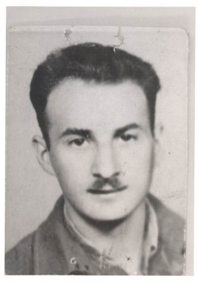 "Aron in Budapest, 1945, while en route from Poland to Italy with Brihah, moving to Palestine. In Aron's words: ""We got connected with the Brihah in Poland, got directions to go to Bratislava and on to Budapest. On our trip, we didn't know where we going from city to city, only our final destination.""  July 5, 1945, Budapest, Hungary."