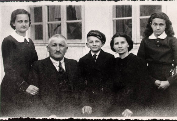 Lisa and her family. From left to right: Pola (sister), Herschel (father), Borushek (brother) Gittel (mother), and Lisa (about 13 years old in this photograph). Lisa's father exported geese to Germany for a living. Photograph taken in Raczki, Poland, ca. 1939.