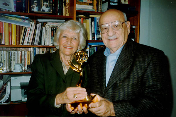 Aron and Lisa with the Emmy they won for their 1997 documentary, A Journey of Remembrance. Photograph taken in Northbrook, Illinois, 1998.