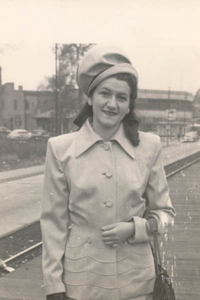 Lisa wearing the first suit she bought in America (Aron recollected that it was taupe). Lisa's aunt, Faye Abrams, gave her the money to buy this suit. Photograph taken in 1947 in Chicago, Illinois, at the Illinois Central station, 75th street (Lisa was either coming or going from downtown).