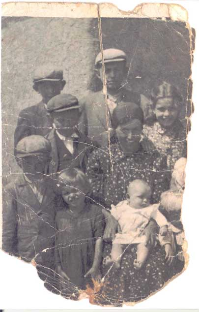 Portrait of the Rot family, taken by a photographer in Munkacs ghetto, Hungary, 1944. After the Holocaust, Miriam—the eldest daughter—recovered this photograph. It is the only surviving portrait of her family.