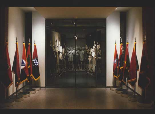 Flags of US Army liberating divisions line the entrance to the Museum's Liberation 1945 exhibition, on display from May 1995–June 1996.