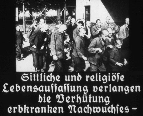 "This image originates from a film produced by the Reich Propaganda Ministry. It is captioned: ""A moral and religious conception of life demands the prevention of hereditarily ill offspring."" Nazi propaganda aimed to create public support for the compulsory sterilization effort."
