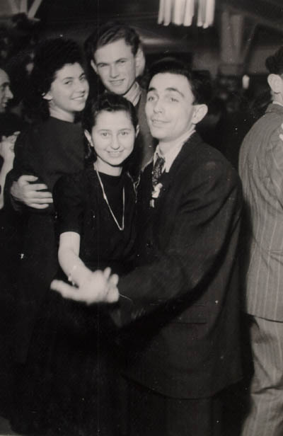 Regina (top, left) with friends at a dance in Berlin. Germany, December 26, 1946.