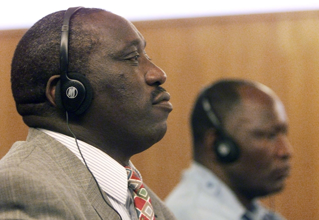 Singer Simon Bikindi sits at the International Criminal Tribunal for Rwanda during his trial for incitement to genocide. Arusha, Tanzania, April 4, 2002.