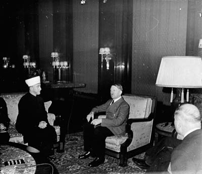 The Grand Mufti of Jerusalem, Hajj Amin al-Husayni, meets Hitler for the first time. Berlin, Germany, November 28, 1941. For more about the meeting and to view film footage, scroll to the end of the article.