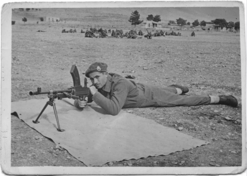 Leon Idas learning how to use captured arms at a training session. Greece, date uncertain.