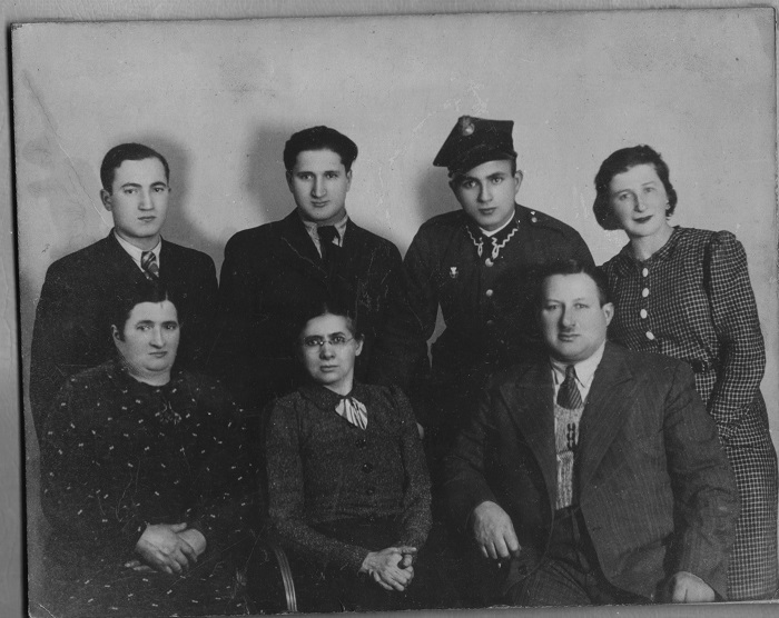 Noah Lewin (top left) family portrait. Bottom left, Noah's mother Sara, his aunt Basia visiting from the United States, his father Yitzak. On upper left, Noah, his younger brother Chaim, next to him in the military uniform is his brother Leon and on the end his aunt Mariasa.