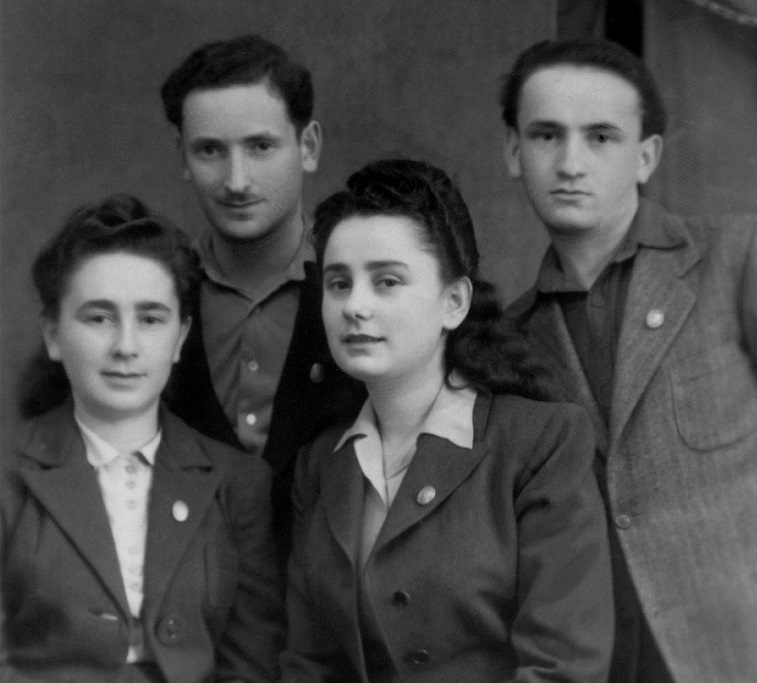 Mira Shelub (front left) in a family portrait after the war. From left to right, Mira Shelub, Norman Shelub, Mira's sister Sarah Rosnow, and her brother, Moris Rosnow. Austria, 1947.