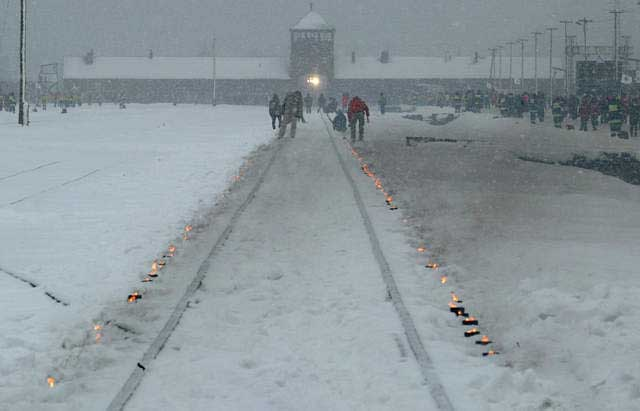 Candles mark the railway tracks leading to the Auschwitz camp during the commemoration of the 60th anniversary of the liberation of the camp. Poland, January 27, 2005.