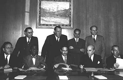 Representatives of four states who ratified the Genocide Convention on October 14, 1950: (seated, left to right) Dr. John P. Chang (Korea), Dr. Jean Price-Mars (Haiti), Assembly President Amb. Nasrollah Entezam (Iran), Amb. Jean Chauvel (France), Mr. Ruben Esquivel de la Guardia (Costa Rica), (standing, left to right) Dr. Ivan Kerno (Asst. Secretary General for Legal Affairs), Mr. Trygve Lie (Secretary-General of U.N.), Mr. Manuel A. Fournier Acuna (Costa Rica), and Dr. Raphael Lemkin (crusader for the Genocide Convention). Lake Success, New York, October 14, 1950.