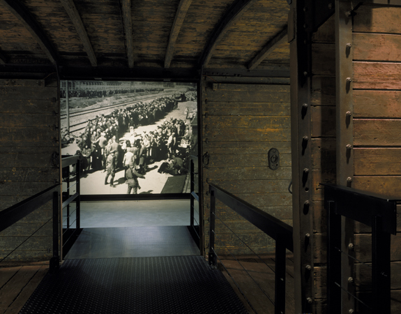 View of the photo mural of a selection at Auschwitz-Birkenau taken through the open railcar on the third floor of the Permanent Exhibition at the United States Holocaust Memorial Museum. Washington, DC, 1993–1995.