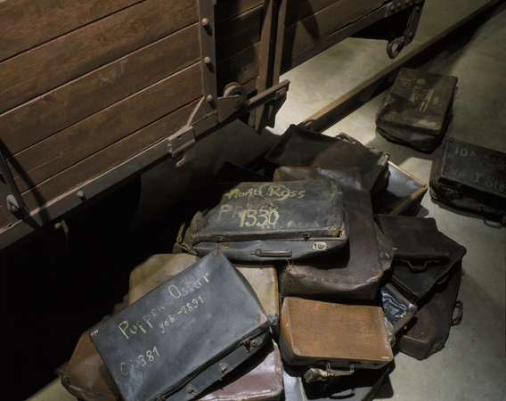 A collection of valises belonging to Jews who were deported to death camps. These valises are displayed at the base of the railcar on the third floor of the Permanent Exhibition at the United States Holocaust Memorial Museum.  Washington, DC, 1993–1995.