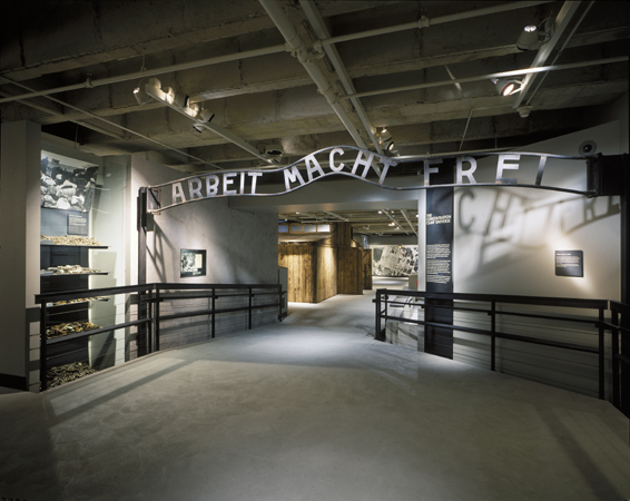 "View of a casting taken of the gate to the main camp at Auschwitz with the sign ""Arbeit Macht Frei,""  displayed on the third floor of the Permanent Exhibition in the United States Holocaust Memorial Museum. Washington, DC, photograph taken between 1993 and 1995."