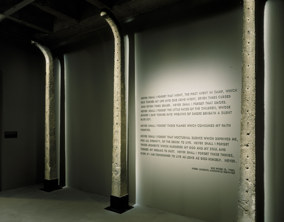 Auschwitz fence posts and Elie Wiesel quote in the third floor tower room of the Permanent Exhibition at the United States Holocaust Memorial Museum.