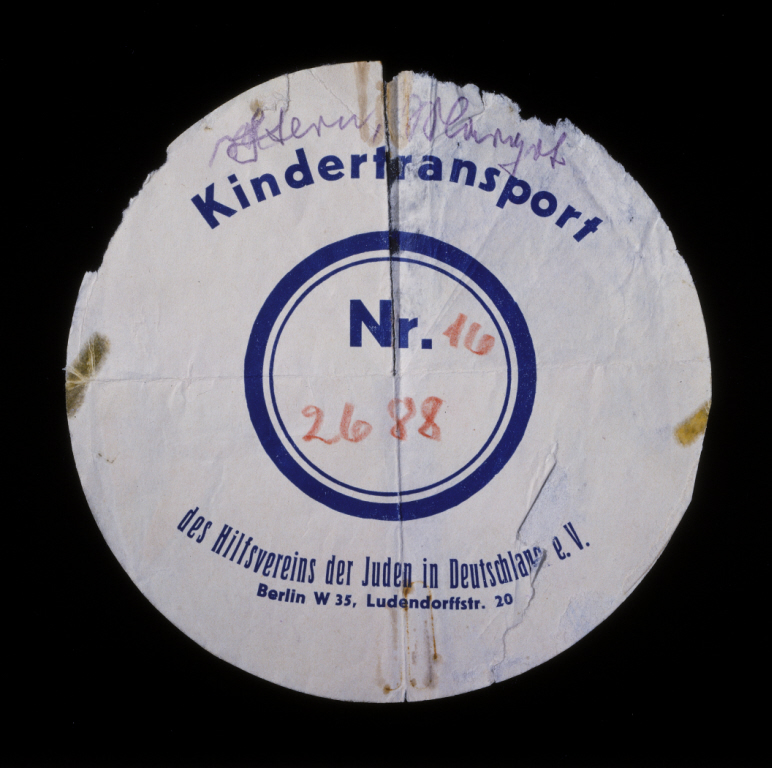 Circular label from the suitcase used by Margot Stern when she was sent on a Kindertransport to England. Germany, December 1938.