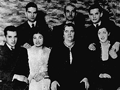 Portrait of the Rosenblat family in interwar Poland. Photographed are: (back row from left to right) Elya, Jozef (father), and Itzrik Rosenblat. Sitting from left to right are: Herschel, Deena (wife of Ely), Hannah (mother), and Taube Rosenblat (wife of Itzrik). In 1941, a mobile killing unit killed Herschel in Slonim, Poland. Of the others, only Itzrik and Deena survived deportation from the ghetto in Radom, Poland.
