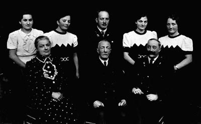 The Greinegger family, shown here in a formal portrait, were prosperous farmers in northern Austria. During World War II, the son died as a soldier in the German army. The second youngest daughter, Frieda, spent almost two years in Ravensbrueck concentration camp for consorting with a Polish forced laborer, Julian Noga. Frieda and Julian married after the war. Place and date of photograph uncertain.