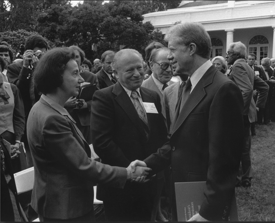 Vladka and Benjamin Meed (center) with President Jimmy Carter at a White House Rose Garden ceremony marking the official presentation of the report of the US Holocaust Commission to the president by commission chairman Elie Wiesel. Washington, DC, September 27, 1979.