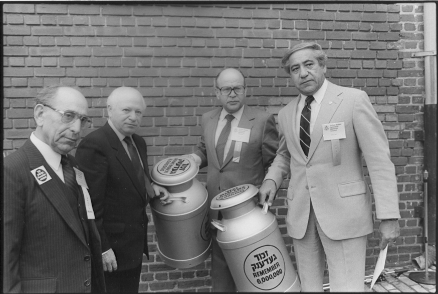 Members of the United States Holocaust Memorial Council pose with two milkcans containing a Scroll of Remembrance signed by Holocaust survivors at the Symbolic Groundbreaking Ceremony of the United States Holocaust Memorial Museum. Benjamin Meed is second from the left. Washington, DC, April 30, 1984.