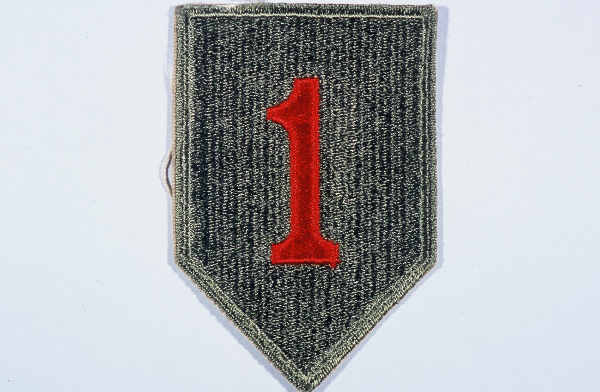 "Insignia of the 1st Infantry Division. The 1st Infantry Division's nickname, the ""Big Red One,"" originated from the division's insignia, a large red number ""1"" on a khaki field. This nickname was adopted during World War I, when the 1st was the first American division to arrive in France."
