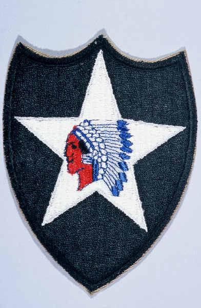 "Insignia of the 2nd Infantry Division. The nickname of the 2nd Infantry Division, ""Indianhead,"" was derived from its World War I insignia. This insignia was developed from an emblem a truck driver in the division had painted on his truck."