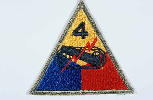 """Insignia of the 4th Armored Division. The commanding general of the 4th Armored Division refused to sanction an official nickname for the 4th, believing that the division's accomplishments on the battlefield made one unnecessary. """"Breakthrough"""" was occasionally used, apparently to highlight the division's prominent role in the breakout from the Normandy beachhead and liberation of France in 1944."""